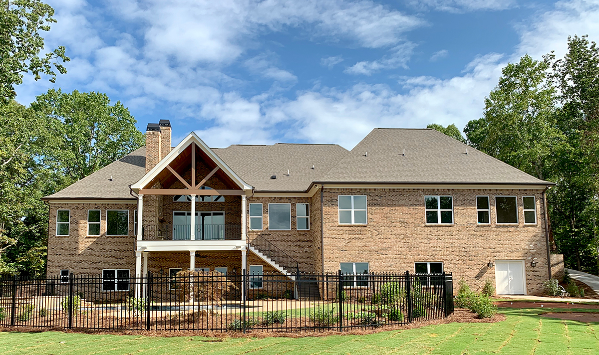 Craftsman, Ranch, Tudor House Plan 52021 with 4 Beds, 5 Baths, 3 Car Garage Rear Elevation